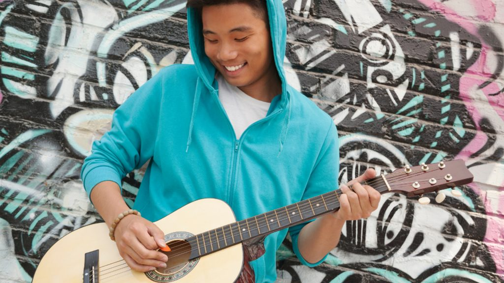 Composition & Songwriting, Male Student with Acoustic Guitar