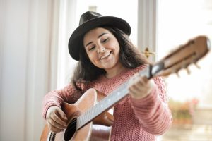 Composition & Songwriting, Female Student with Acoustic Guitar