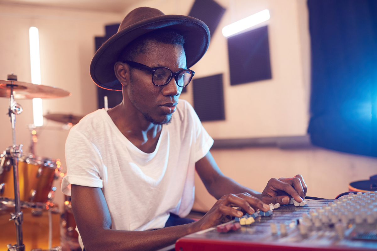 Composition & Songwriting, Male Student with Soundboard